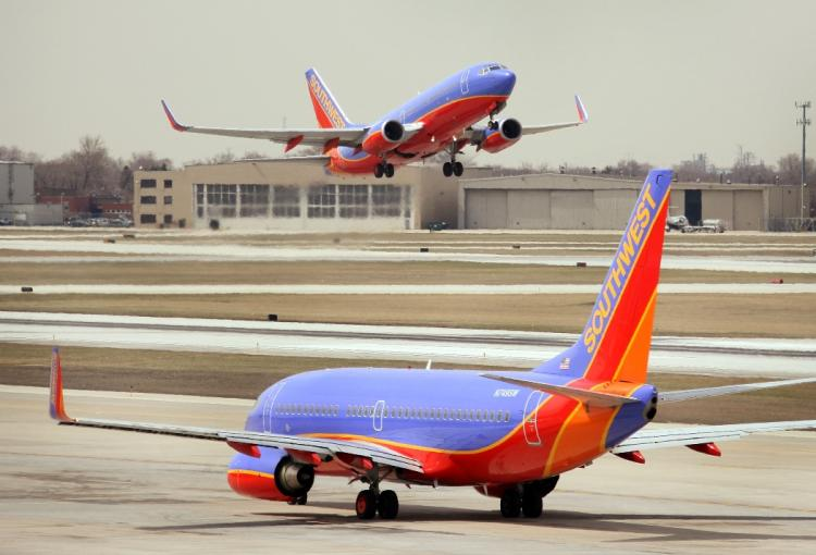 PRIVATIZATION: A jet takes off at Midway Airport on April 3, 2008 in Chicago, Illinois. Midway may become the first major airport to be privatized. (Scott Olson/Getty Images)
