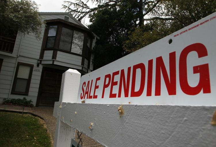 Mortgage loans with record-low rates have led to an increase in pending home sales for the second straight month. (Justin Sullivan/Getty Images)