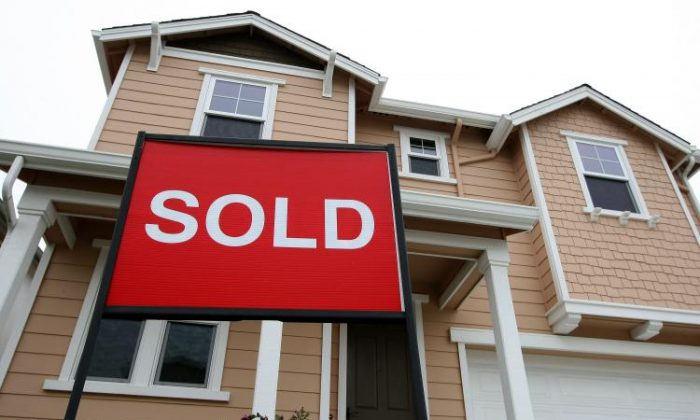 A sold sign is posted in front of a home in a new housing development in San Francisco, in this file photo. (Justin Sullivan/Getty Images)