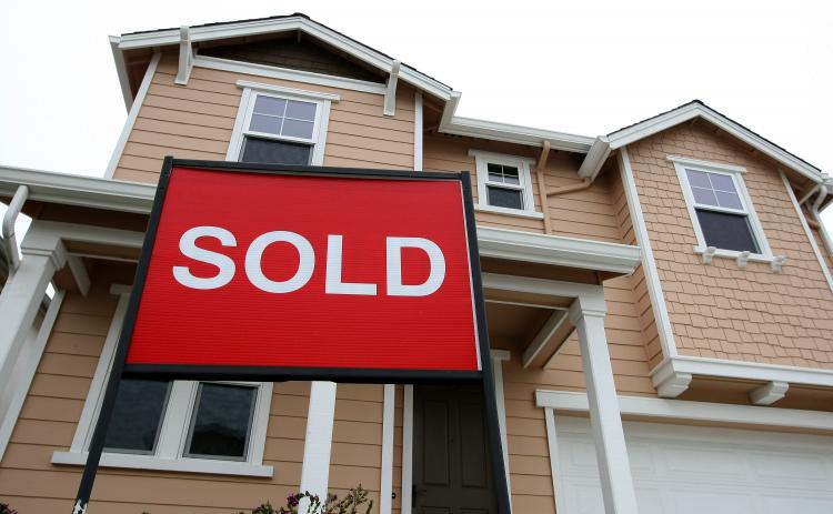 A sold sign is posted in front of a home in a new housing development May 4, 2009 in South San Francisco, California. (Justin Sullivan/Getty Images)