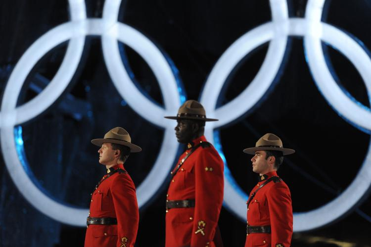 Mounties stand next to Olympic rings during the closing ceremony of the 2010 Winter Games in Vancouver. Violations of free expression during the Olympics was one of the topics covered in a new report by Canadian Journalists for Free Expression. (Dimitar Dilkoff/AFP/Getty Images)