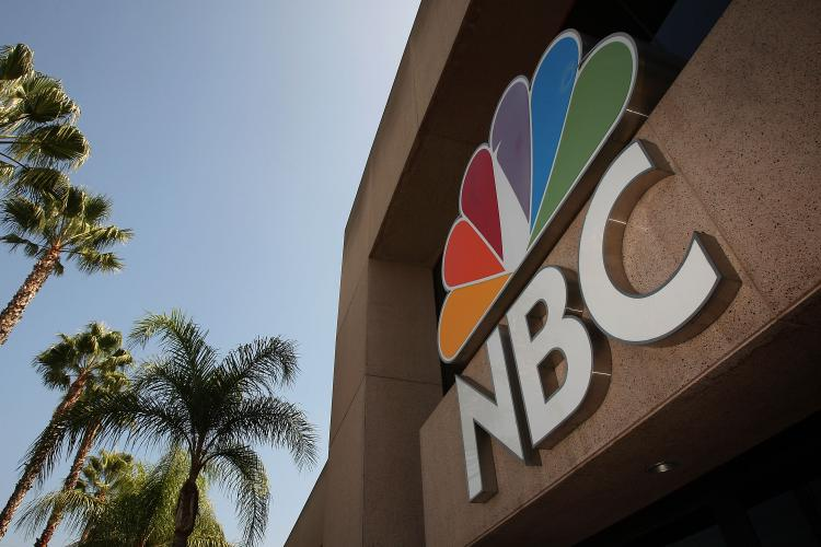 The NBC peacock logo hangs on the NBC studios building last year in Burbank, California. Rumors are swirling that NBC Universal was put up for sale by parent General Electric Co. (David McNew/Getty Images )