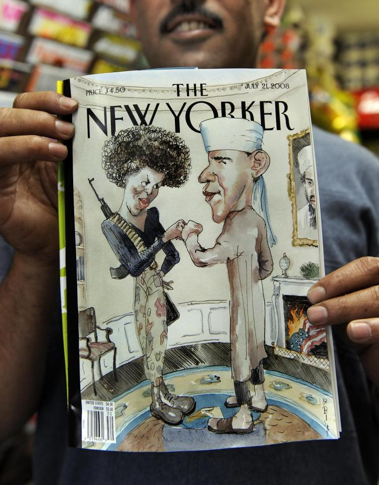 PRESIDENT OBAMA? Taleb Alkardai holds up a copy of the New Yorker magazine cover showing Democratic presidential candidate Barack Obama dressed as a Muslim and his wife as a terrorist at his midtown newsstand on Monday.(Timothy A. Clary/AFP/Getty Images)