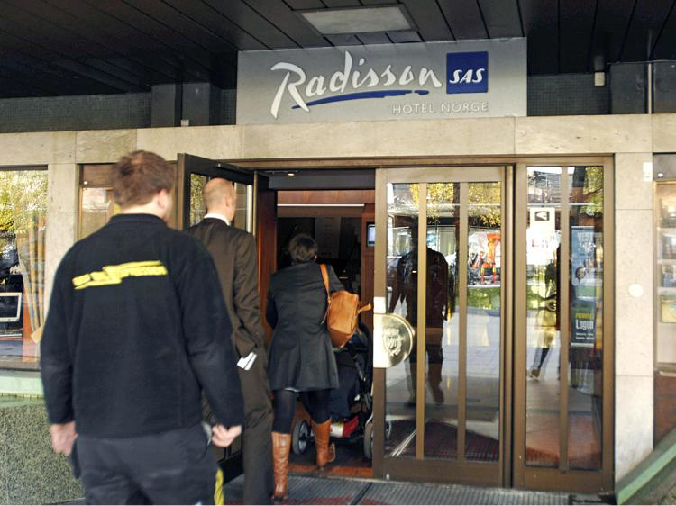 Guests enter the SAS Radisson 'Hotel Norge' in Bergen, Norway.  (Marit Hommedal/AFP/Getty Images)