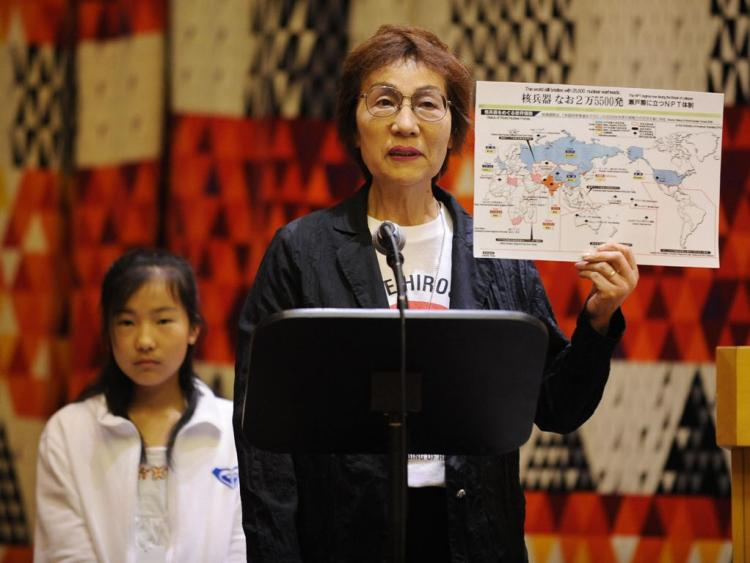 Emiko Okada, a survivor of the Hiroshima atomic bomb, holds a map showing countries with nuclear weapons during a meeting on nuclear disarmament organized by the Mayors for Peace at U.N. headquarters in New York in May. (Stan Honda/AFP/Getty Images)