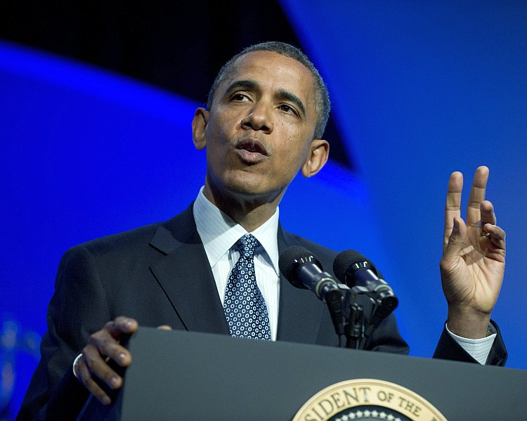 President Barack Obama waves at supporters
