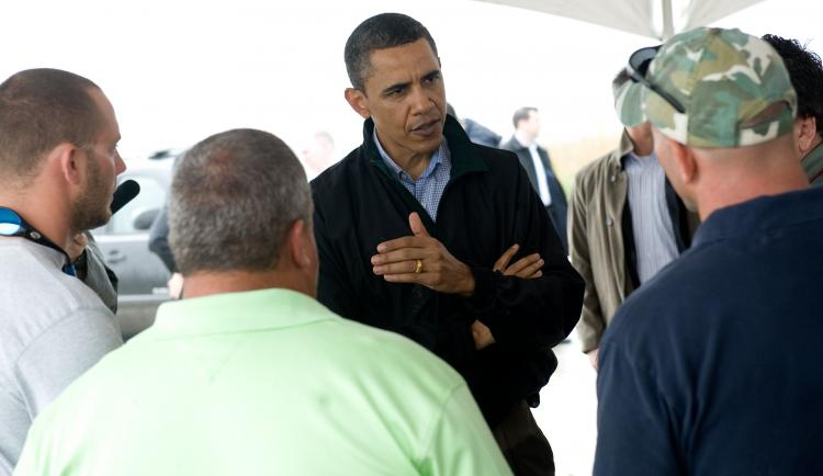 U.S. President Barack Obama speaks with local fishermen about how they are affected by the BP oil spill after meeting with officials at Coast Guard Station Venice in Venice, LA., May 2.  (Saul Loeb/Getty Images)