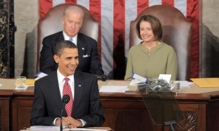 US President Barack Obama, flanked by US Vice President Joe Biden and Speaker of the House Nancy Pelosi, addresses a Joint Session of Congress at the Capitol in Washington on Feb. 24, 2009. (Saul Loeb/AFP/Getty Images)