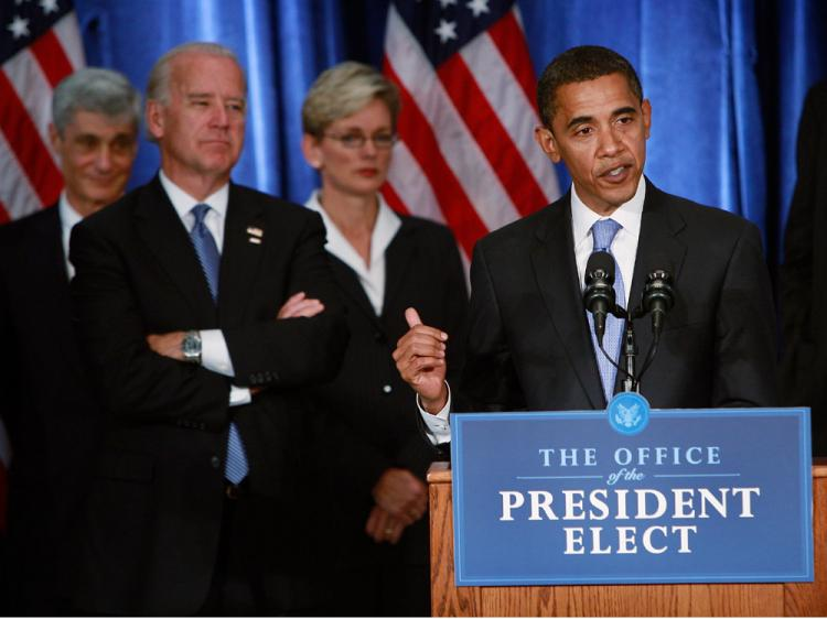 President-elect Barack Obama holds his first post-election press conference at the Hilton Hotel flanked by his vice president-elect Joe Biden (2nd L) and members of his Transition Economic Advisory Board November 7, 2008 in Chicago, Illinois.    (Scott Olson/Getty Images)