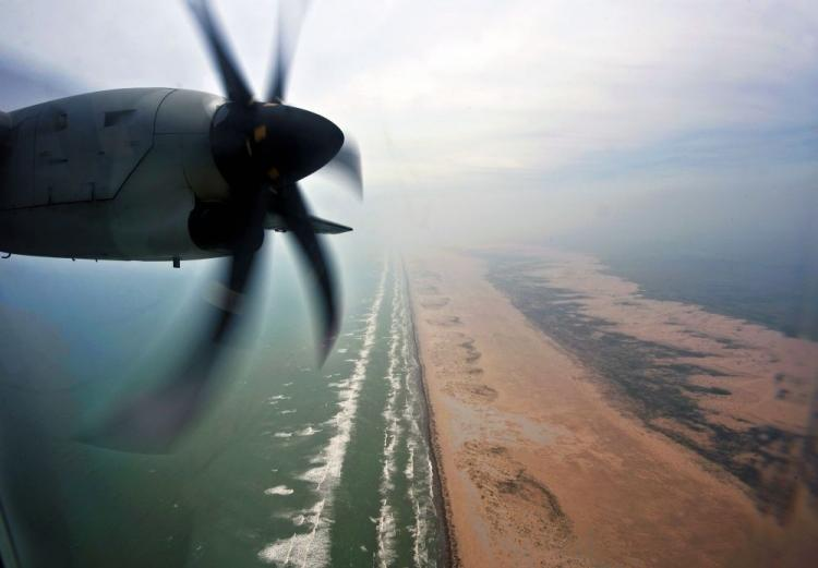 A Mexican Navy plane overflies the Tamaulipas State coastline on May 12, 2010, during an inspection flight looking for oil spills from the sunk Deepwater Horizon oil rig. (Ronaldo Schemidt/AFP/Getty Images)