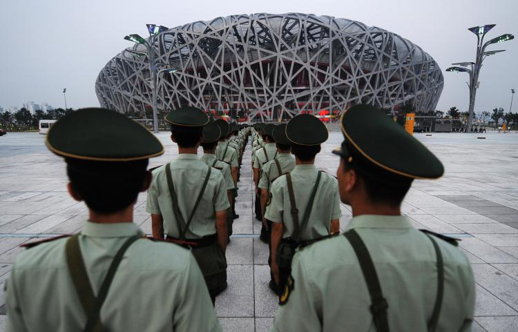 Chinese paramilitary soldiers rehears their security drills outside the main Olympic Stadium, also known as the Bird's Nest. (Frederick J. Brown/AFP/Getty Images)