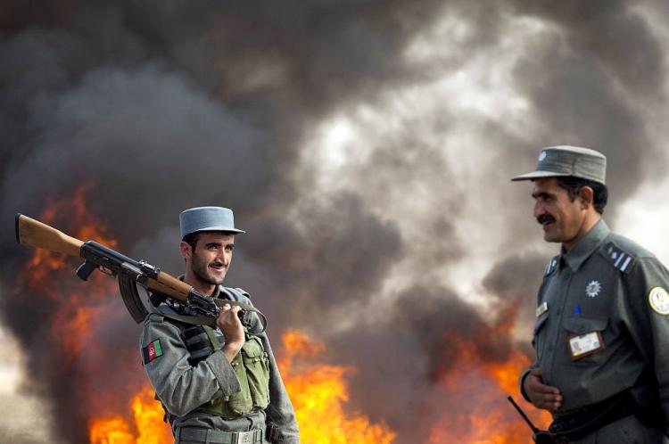 Confiscated opium is destoyed as a security officers stand by Nov. 3, 2010 in Herat, Afghanistan. Afghanistan is the source of 90 percent of the world's opium, much of which is smuggled across the Pakistani border.  (Majid Saeedi/Getty Images)