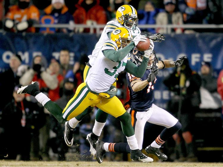 Quarterback Aaron Rodgers and the Green Bay Packers look ahead to next week's NFC Championship Game against the Chicago Bears. (Jonathan Daniel/Getty Images )