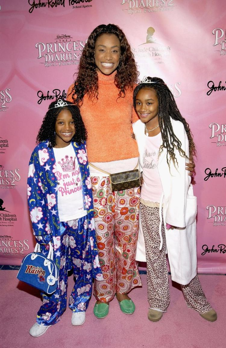 PAJAMA PARTY: Actress Tami Anderson and her daughters Kenni (left) and Lyric (right) arrive at 'The Princess Diaries 2: Royal Engagement' DVD Party in 2004. (Amanda Edwards/AFP/Getty Images)