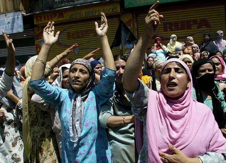 Kashmiri Muslim women shout pro-freedom slogans during a protest in Srinagar.  (Rouf Bhat/AFP/Getty Images)