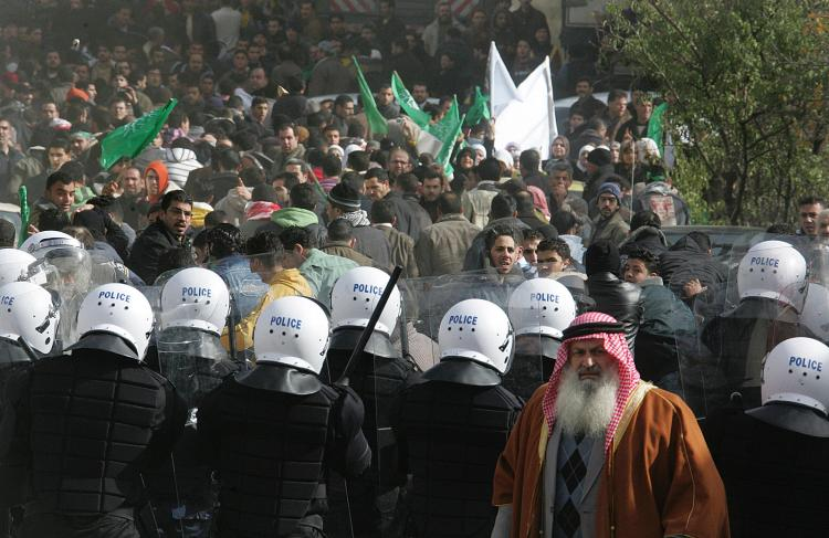 Palestinian security forces keep watch during a Hamas demonstration in the West Bank city of Hebron on January 02, 2009. Thousands of Palestinians held angry protests after Hamas called for a 'day of wrath' against Israel's Gaza campaign.    (Hazem Bader/AFP/Getty Images)