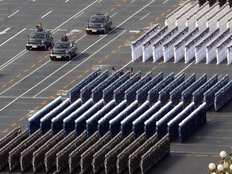 Chinese President Hu Jintao (3L car) reviews the military personnel during the National Day parade in Beijing on October 1, 2009. (AFP/AFP/Getty Images)