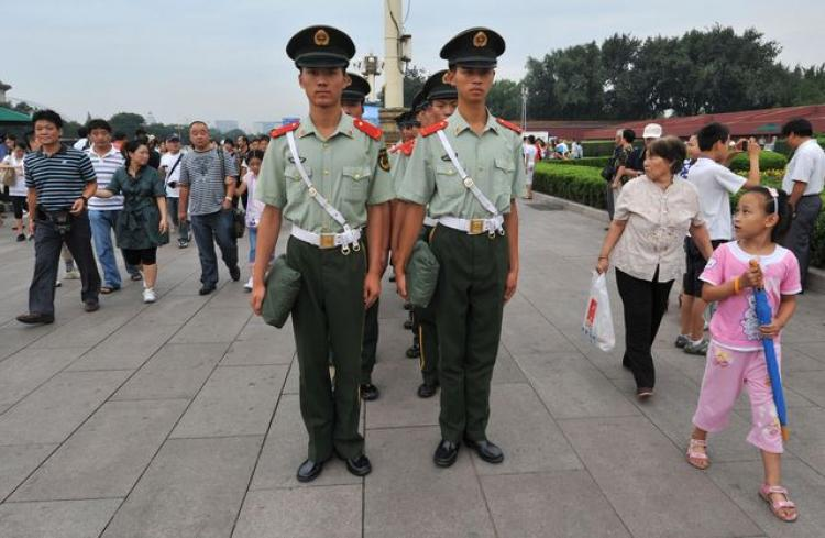 Military police squad patrols Tiananmen Square. (Ted Aljibeapp/Getty Images)