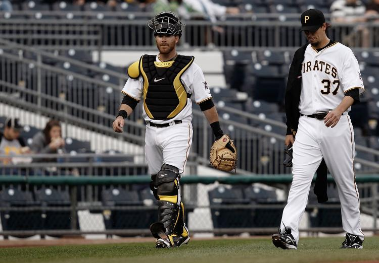 Pittsburgh's Ryan Doumit (left) and Charlie Morton prepare to face the Milwaukee Brewers in late April. The Pirates would be swept, losing 36-1 over three games. (Jared Wickerham/Getty Images)