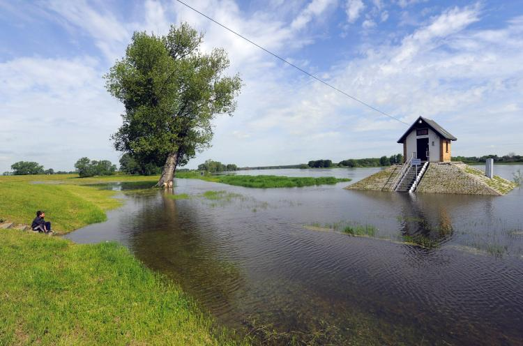 Floods in Poland surround a water-level control point standing on the plains of the Oder river in Ratzdorf near the Polish-German border on May 24. Floods sweeping across Poland have killed 10 people in the past week, and have caused billions of dollars in damage. (Theo Heimann/Getty Images)