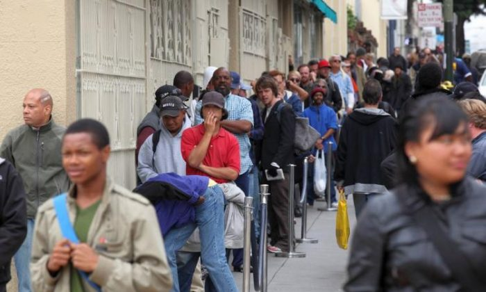 People line up to receive a free meal at the St. Anthony foundation dining room in San Francisco, Calif., on Sept. 16, 2010. (Justin Sullivan/Getty Images)