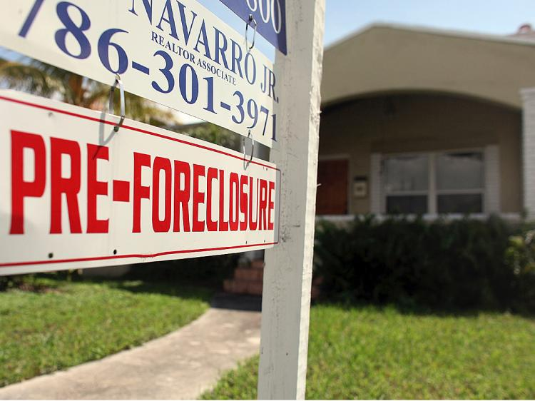 One of every four homeowners owes more on the mortgage than the value of the home. (Joe Raedle/Getty Images)