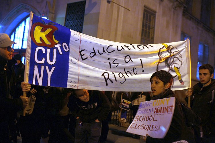 People protest outside during a Panel for Educational Policy