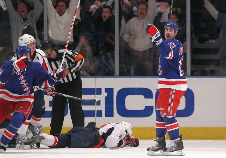 STUNNING: Rangers' center Brandon Dubinsky (right) celebrates after scoring the game winner that defeated the Washington Capitals 3-2 in Game 3 at Madison Square Garden on Sunday. (Bruce Bennett/Getty Images)