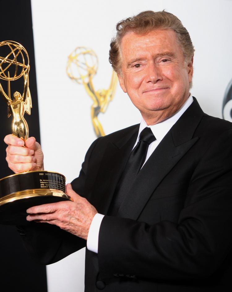 TV host Regis Philbin poses with the Lifetime Achievement at the 35th Annual Daytime Emmy Awards held at the Kodak Theatre on June 20, 2008 in Hollywood, California. Regis Philbin has been selected to host the 2010 Daytime Emmy Awards.  (Frederick M. Brown/Getty Images)