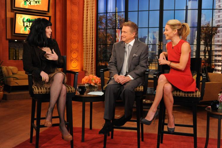Regis Philbin (C) and Kelly Ripa (R) talk with Cher on 'Live! with Regis and Kelly' in a November 2010 file photo. Philbin has announced he is leaving the show after 28 years. (David M. Russell/Disney ABC via Getty Images)