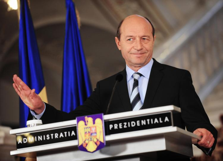Romanian President Traian Basescu gestures during a press conference on Dec. 15, 2008. He recently declared that Romania is less worried about the financial crisis. (Daniel Mihailescu/AFP/Getty Images)