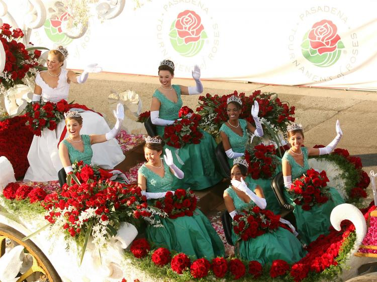 The Rose Queen & Royal Court float members wave on the parade route at the 118th Tournament of Roses Parade on January 1, 2007 in Pasadena, California.  (Frederick M. Brown/Getty Images)