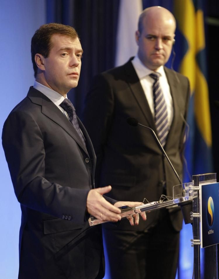 Russian President Dmitry Medvedev (L) delivers a speech at the EU-Russia summit with Swedish Prime Minister Fredrik Reinfeldt (R) in Stockholm on Nov. 18, 2009.  (Vladimir Rodionov/AFP/Getty Images)