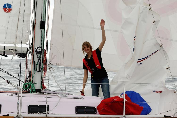 Teen solo sailor Jessica Watson, 16, sets sail on her yacht Ella's Pink Lady in Sydney Harbor on October 18, 2009, in Australia.  (Brendon Thorne/Getty Images)