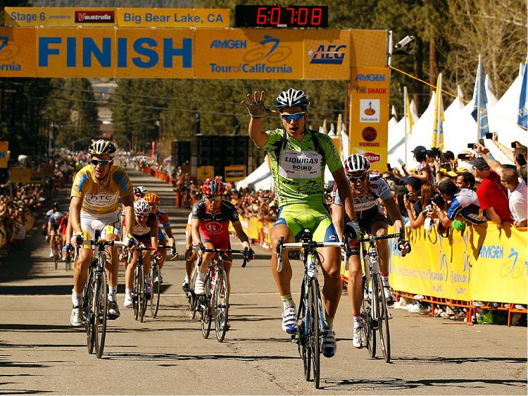 Peter Sagan holds up five fingers, denoting five race wins in 2010, as he crosses the finish line first in Stage Six of the Amgen Tour of California. (Chris Graythen/Getty Images)