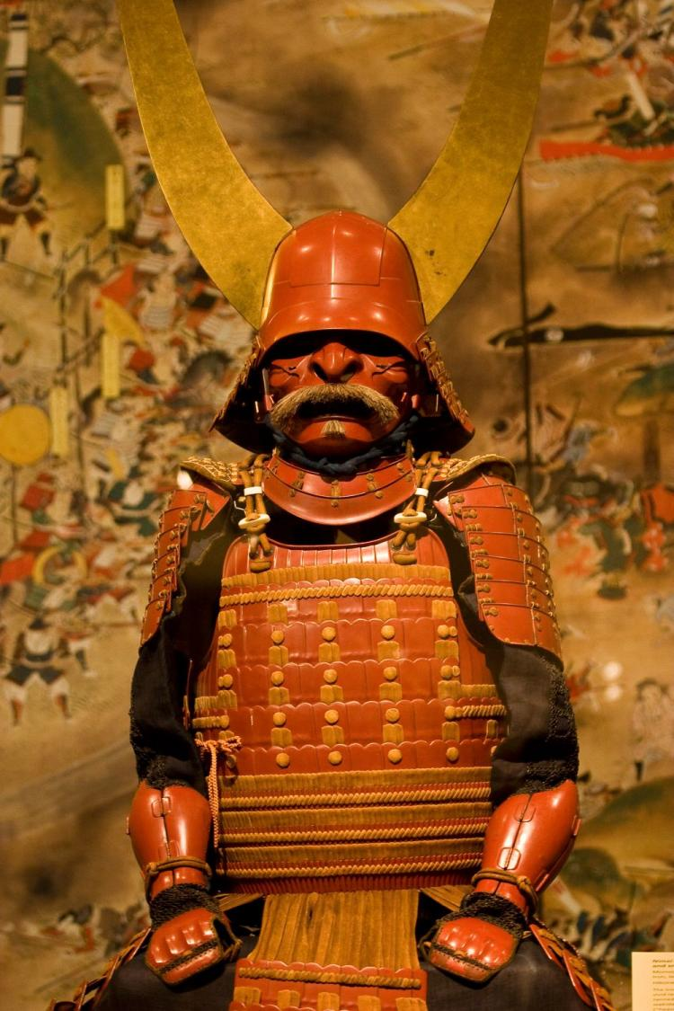 Majestic 17th century cuirass 'gusoku' armor with red lacquer and smoked-leather lacing, on display at the Metropolitan Museum of Art beginning Wednesday.  (Dan Skorbach/The Epoch Times)