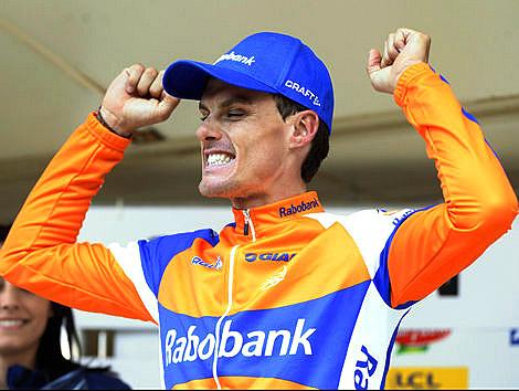 Luis Leon Sanchez exults on the podium after winning Stage Six of the Tour of Romandie. (rabosport.com)