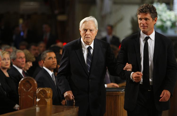 Sargent Shriver, former JFK aide and Peace Corps founder, died Tuesday at the age of 95. Above, Shriver (L) is accompanied by his son Anthony Kennedy Shriver (R) at the funeral services of Senator Edward Kennedy in a August 2009 file photo. (Brian Snyder-Pool/Getty Images)