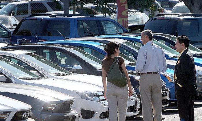 Customers shop for cars at a dealership in Glendale, Calif. (David McNew/Getty Images)