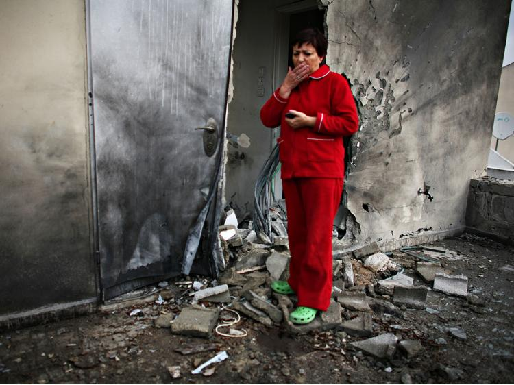 Israeli Maya Iber inspects damage at a her destroyed house after a rocket attack by Palestinian militants on in Sderot, Israel.   (Uriel Sinai/Getty Images)