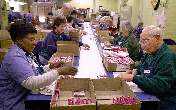 Older workers package cosmetics on the assembly line at the Bonne Bell cosmetics factory in Lakewood, Ohio.   (David Maxwell/AFP/Getty Images)