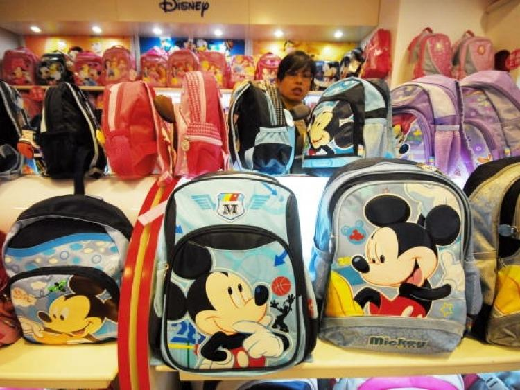 A Chinese vendor sells Mickey Mouse bags and other products at the Disney flagship store in Shanghai on November 4, 2009. China has given the green light for Walt Disney Co. to build its first theme park on the mainland in Shanghai. (STR/AFP/Getty Images)