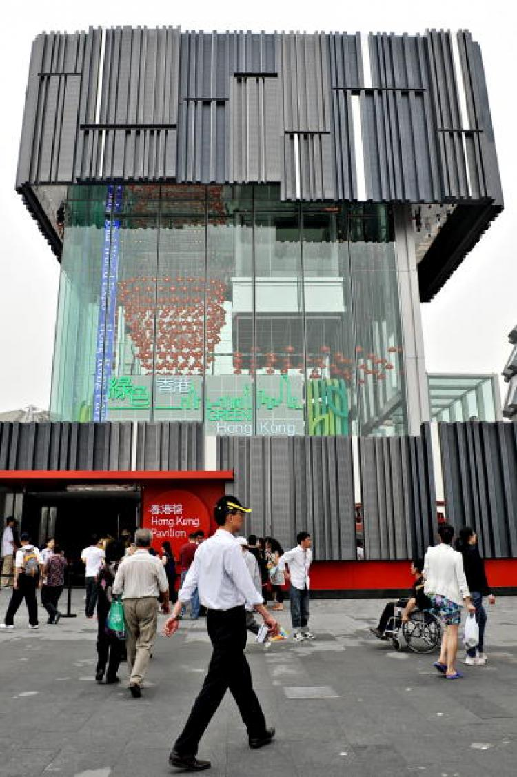 A man walks past the Hong Kong pavilion at the site of the World Expo 2010 on May 6. Attendance figures at the Shanghai Expo were lower than officals had expected. (Philippe Lopez/AFP/Getty Images)