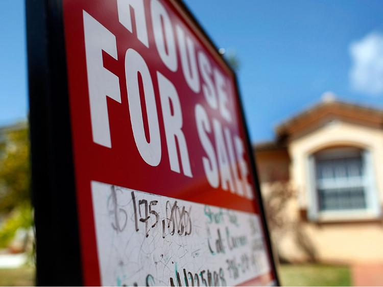 The National Association of Realtors announced that sales of existing homes grew 5.1 percent to an annual rate of 4.72 million last month, from 4.49 million units in January.  (Joe Raedle/Getty Images)