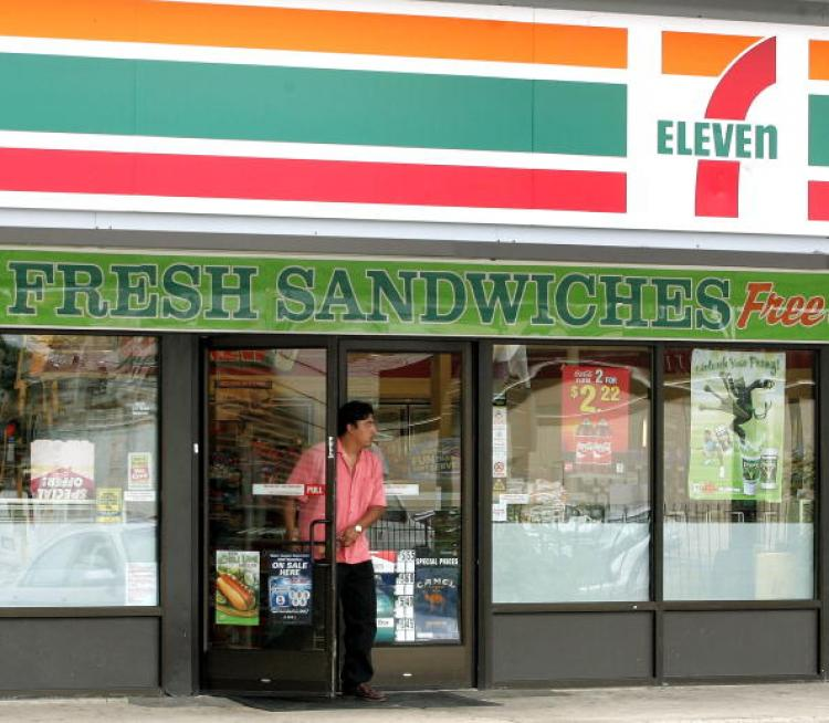 7-Eleven stores all across the country are giving away free Slurpees away on July 7 (7-11) in regular 7.11 oz cups.   (Tim Boyle/Getty Images)