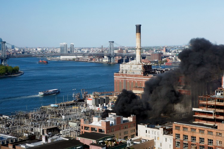 Smoke rises from a Con Edison power plant