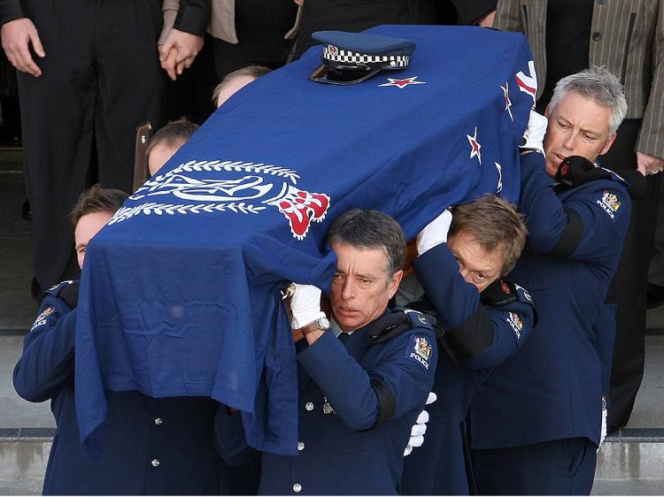 Officers carry the casket of Senior Constable Len Snee after his funeral on May 13, 2009 in Napier, New Zealand. (Marty Melville/Getty Images)