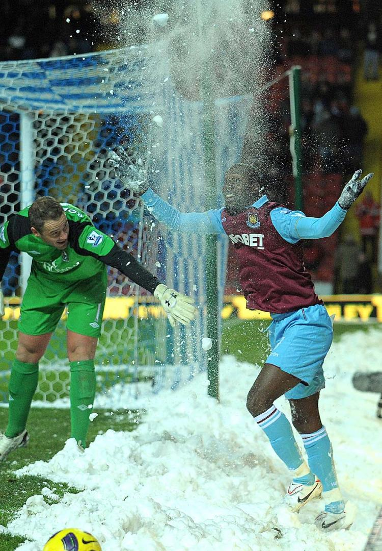 PLAYING IN THE SNOW: West Ham's Carlton Cole tries to make the best of a trying time for players in the English Premier League. (Andrew Yates/AFP/Getty Images)