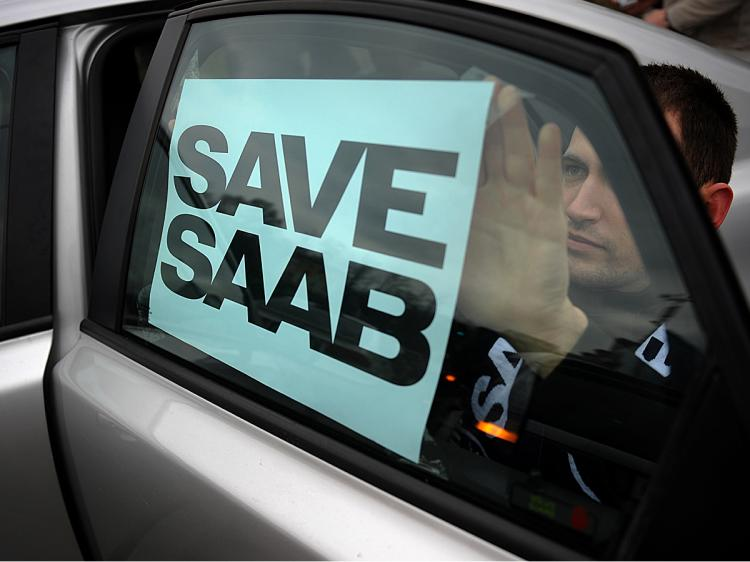 A man puts a 'Save Saab' sign on his car during a demonstration in front of a former showroom of Saab in Sofia, Bulgaria, part of the world-wide Saab Support Convoy campaign, January 16, 2010. (Nikolay Doychinov/AFP/Getty Images)