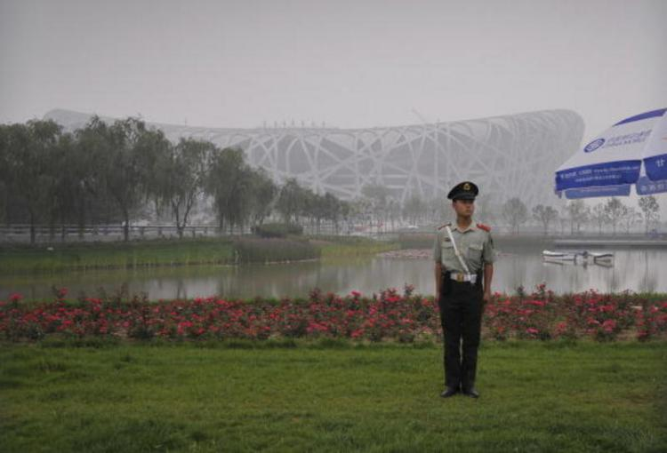 Beijing's National Stadium, the Bird's Nest, under Para-military police guard.Beijing was awarded the Olympic Games venue seven years ago. Despite the Birds Nest, no one can fly free, like a bird emerging from its nest. (Peter Parks/AFP/Getty)